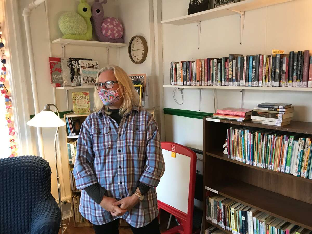 Julie Rockefeller runs the Book Nook, a free lending library for children and adults, since there is no public library nearby.