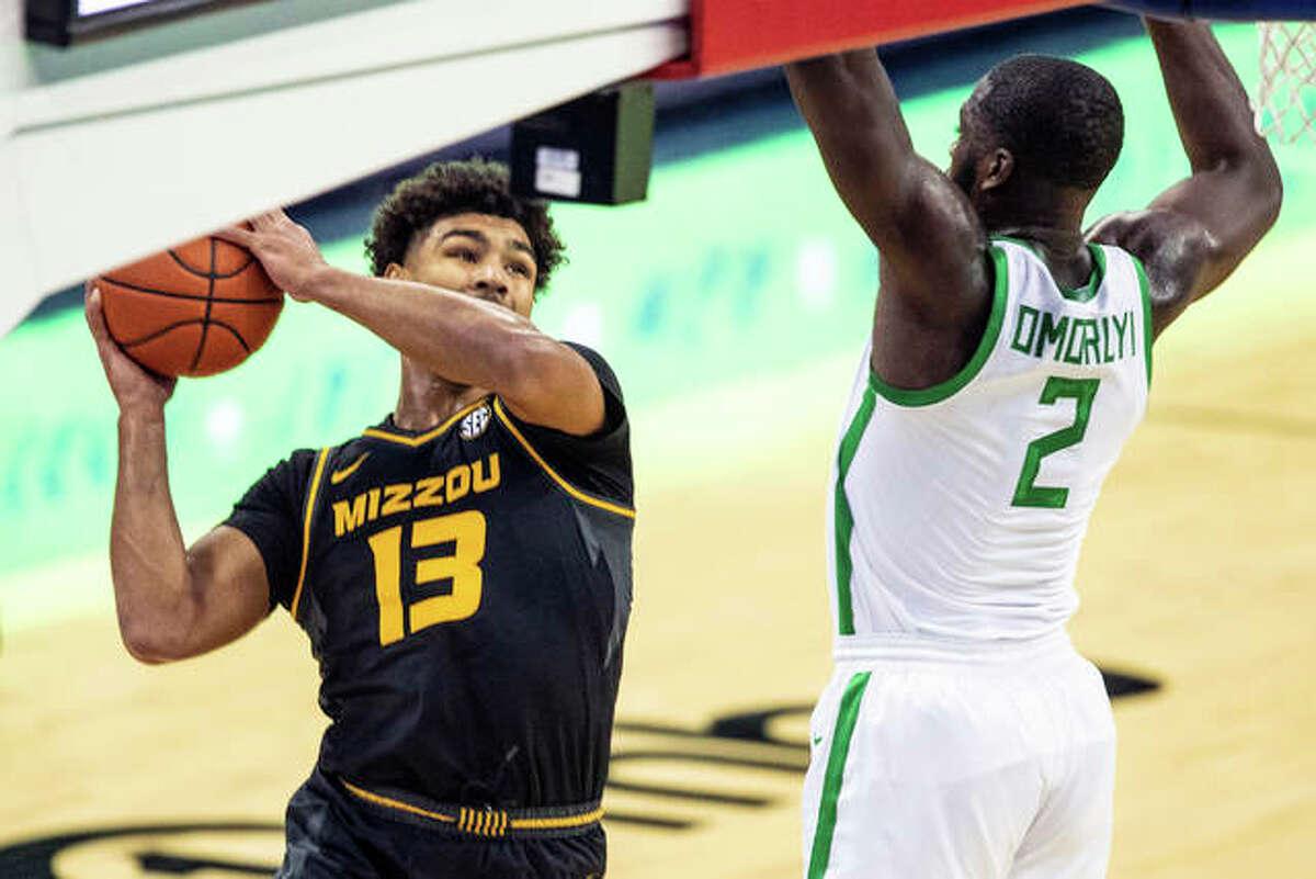 Missouri's Mark Smith (13) looks to pass around Oregon's s Eugene Omoruyi during an NCAA college basketball game, Wednesday, Dec. 2, 2020 in Omaha, Neb.
