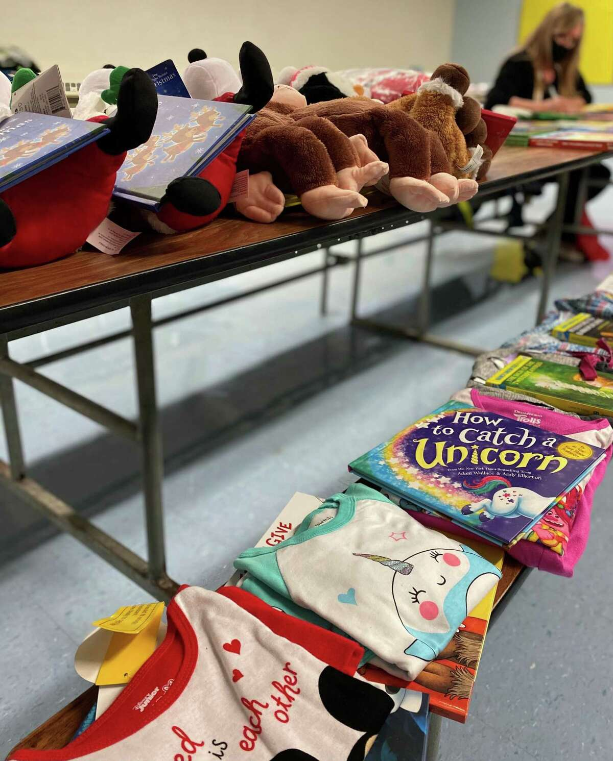 Spectrum/Local members of the Charles Merriman Chapter, Children of the American Revolution, the Roger Sherman Chapter, Daughters of the American Revolution and the United Way on Dec. 4, 2020 packaged new pajamas and books into gift bags to be given out to families in need this holiday as part of CAR's