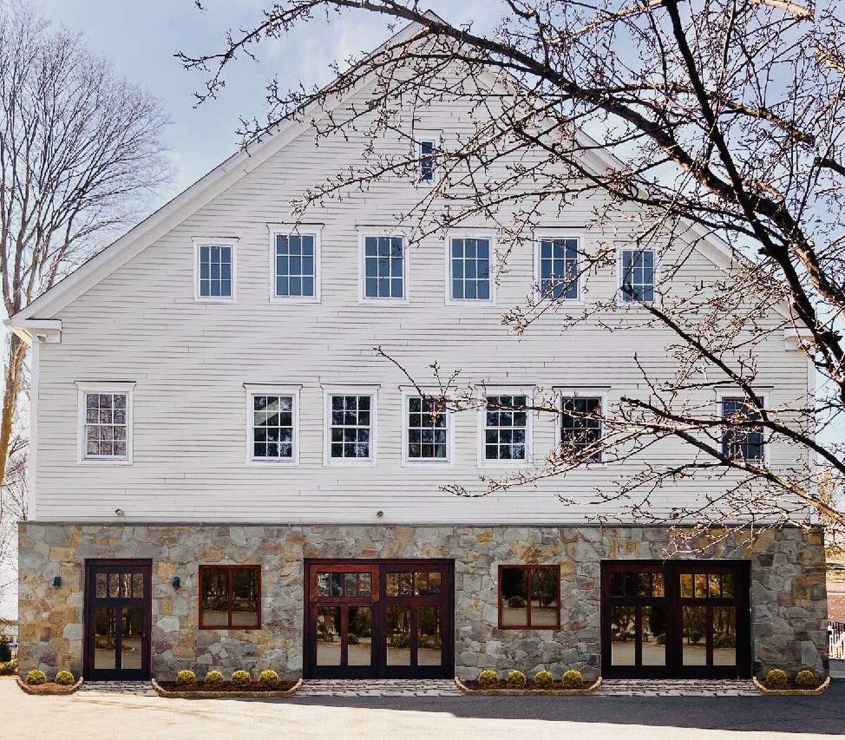 The rear view of Art House, which sits at the intersection of Danbury Road and Hollyhock Road, is being proposed as a conversion from art studio and office space to apartments, several of which would be offered as affordable. Dec. 2020, wilton, ct