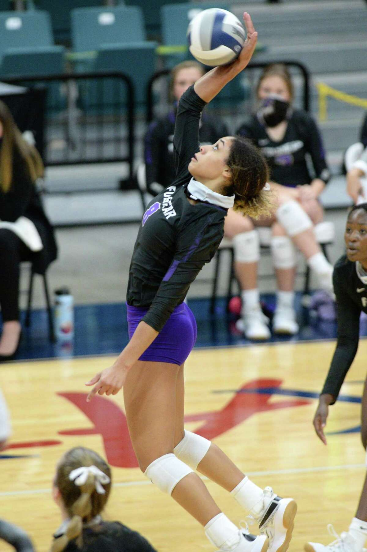 Alexis Dacosta (8) of Fulshear attempts a shot during the third set of the 5A Region 3 Championship between the Fulshear Chargers and the College Station Cougars on Thursday, December 3, 2020 at Leonard Merrell Center, Katy, TX.