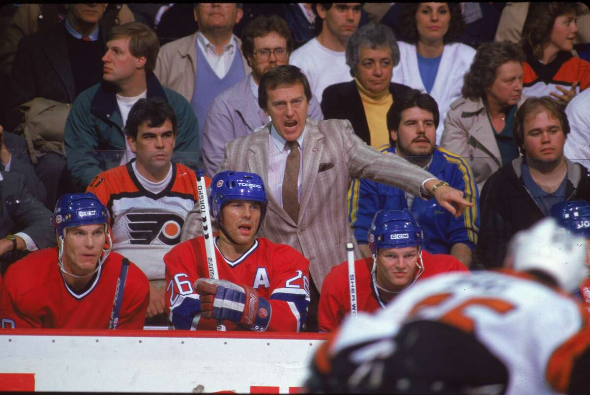 Jean Perron, coach of the Montreal Canadiens, yells fron the bench during a game against the Philadelphia Flyers at the Spectrum, Philadelphia, 1980s.