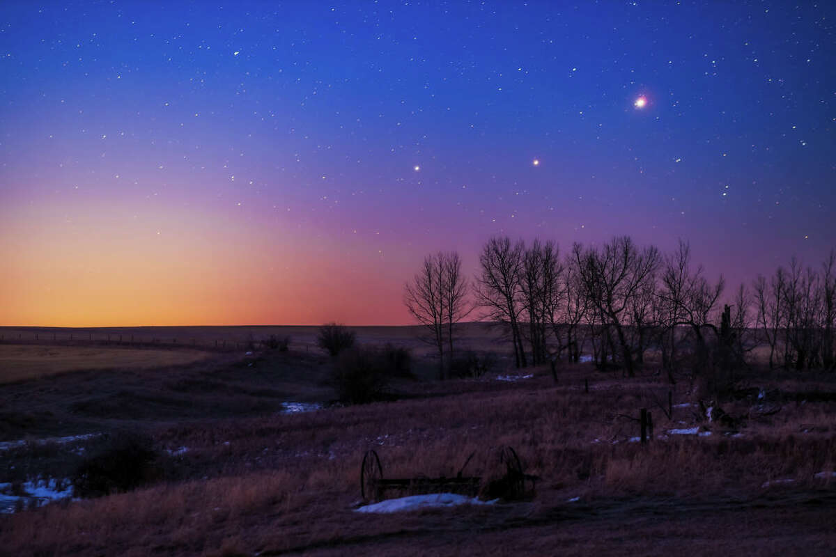 The trio of (L to R) Saturn, Mars and Jupiter in conjunction in the dawn twilight, taken from home in Alberta on March 26, 2020.
