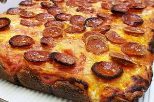 """Some people call Joe's Pizza's Brooklyn Sicilian with Pepperoni pie an """"upside down pizza"""" because the cheese goes directly on the dough and is topped with a plum tomato sauce and Pecorino Romano cheese."""