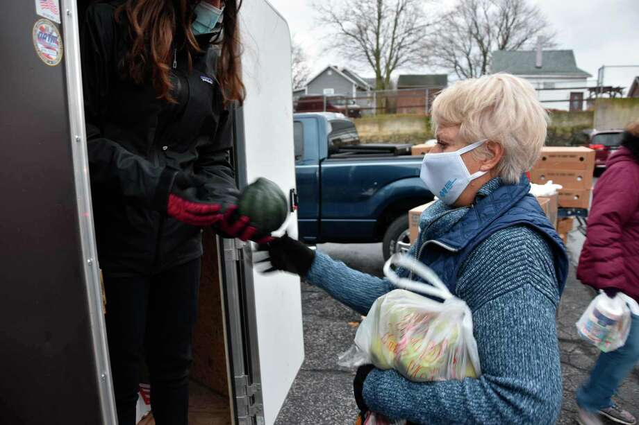 The Nov. 13 Matthew 25:13 food pantry in Manistee saw 700 pounds of potatoes, 700 pounds of apples and 300 pounds of squash donated by the Orchard Market, of Free Soil. (File photo)