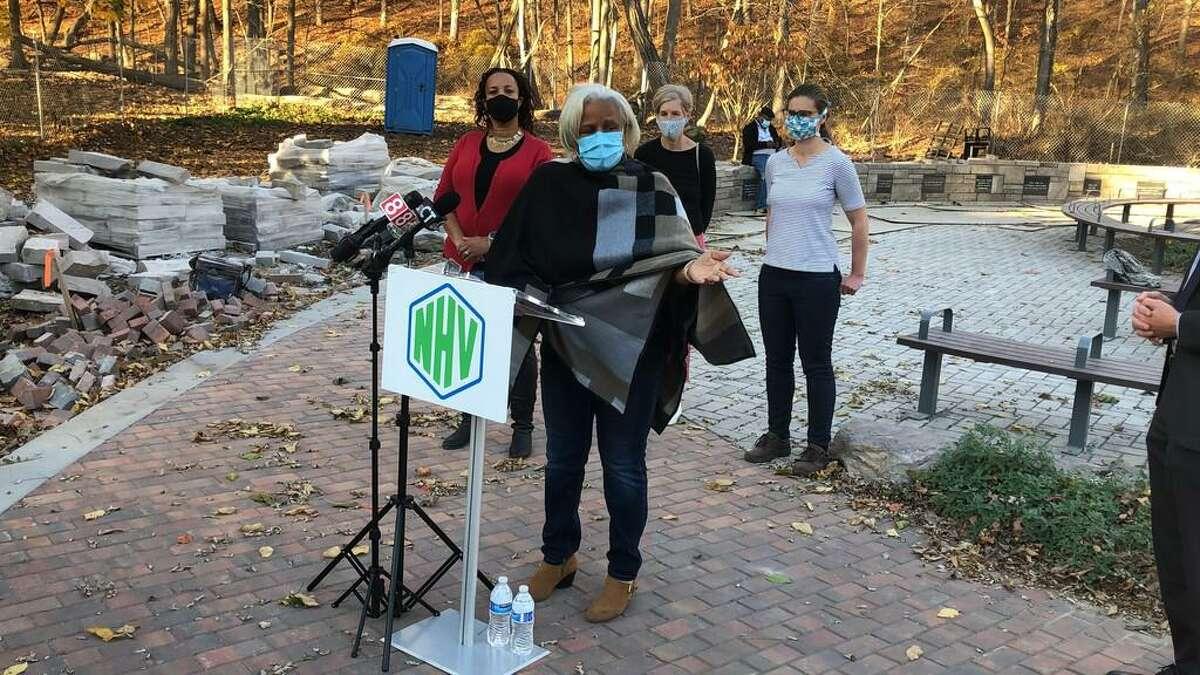 Marlene Miller-Pratt speaks the New Haven Botanical Garden of Healing Dedicated to Victims of Gun Violence in November. Celeste Robinson-Fulcher is to the left.