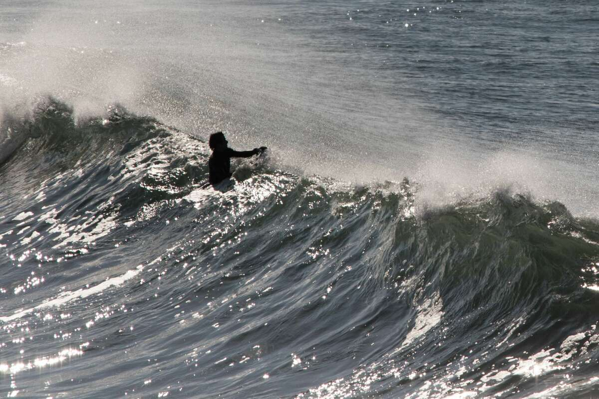 A boogie boarder rides the high waves at Ocean Beach in San Francisco on Dec. 4, 2020.