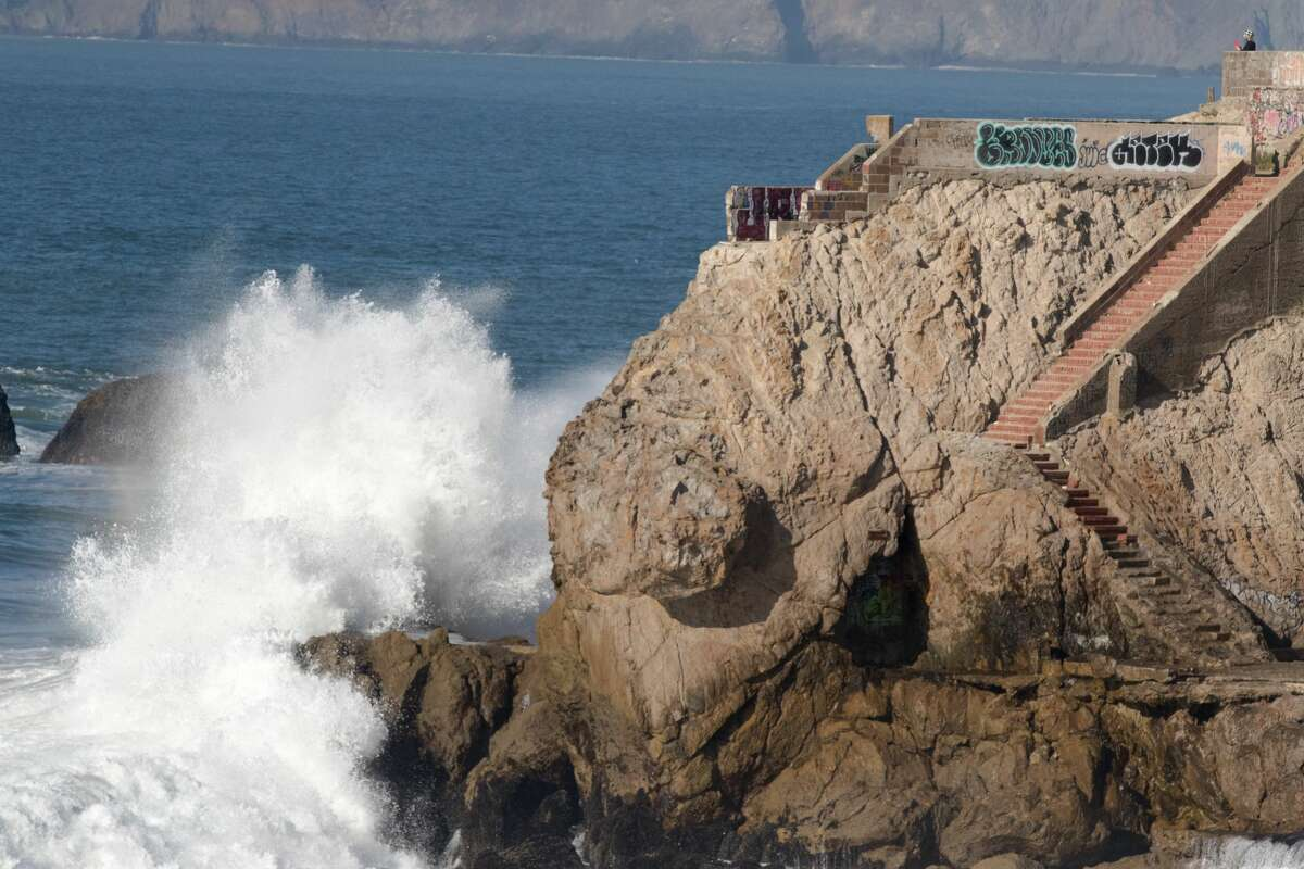 A high wave crashes against the rocks near the Sutro Baths in San Francisco on Dec. 4, 2020.