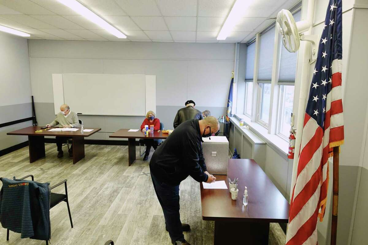 New York ballot access is now restricted to four parties, the two major ones as well as the Conservatives and the Working Families Party. Pictured: Firefighter Robert Fink casts his ballot for the volunteer firefighter referendum at Rensselaer City Hall on Tuesday, Dec. 8, 2020, in Rensselaer, N.Y. (Paul Buckowski/Times Union)