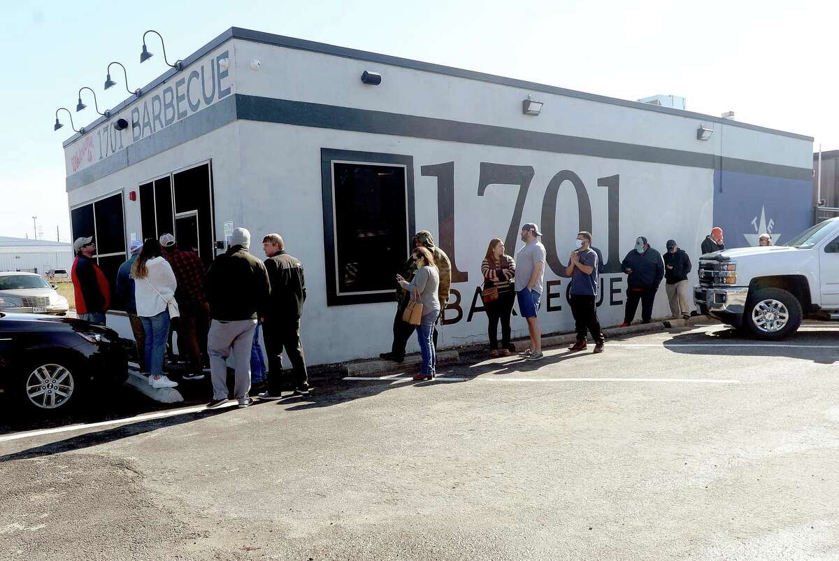 A line wraps around the building at the Friday opening of 1701 Barbecue in Beaumont, which had its grand opening Tuesday. Photo taken Friday, December 4, 2020 Kim Brent/The Enterprise