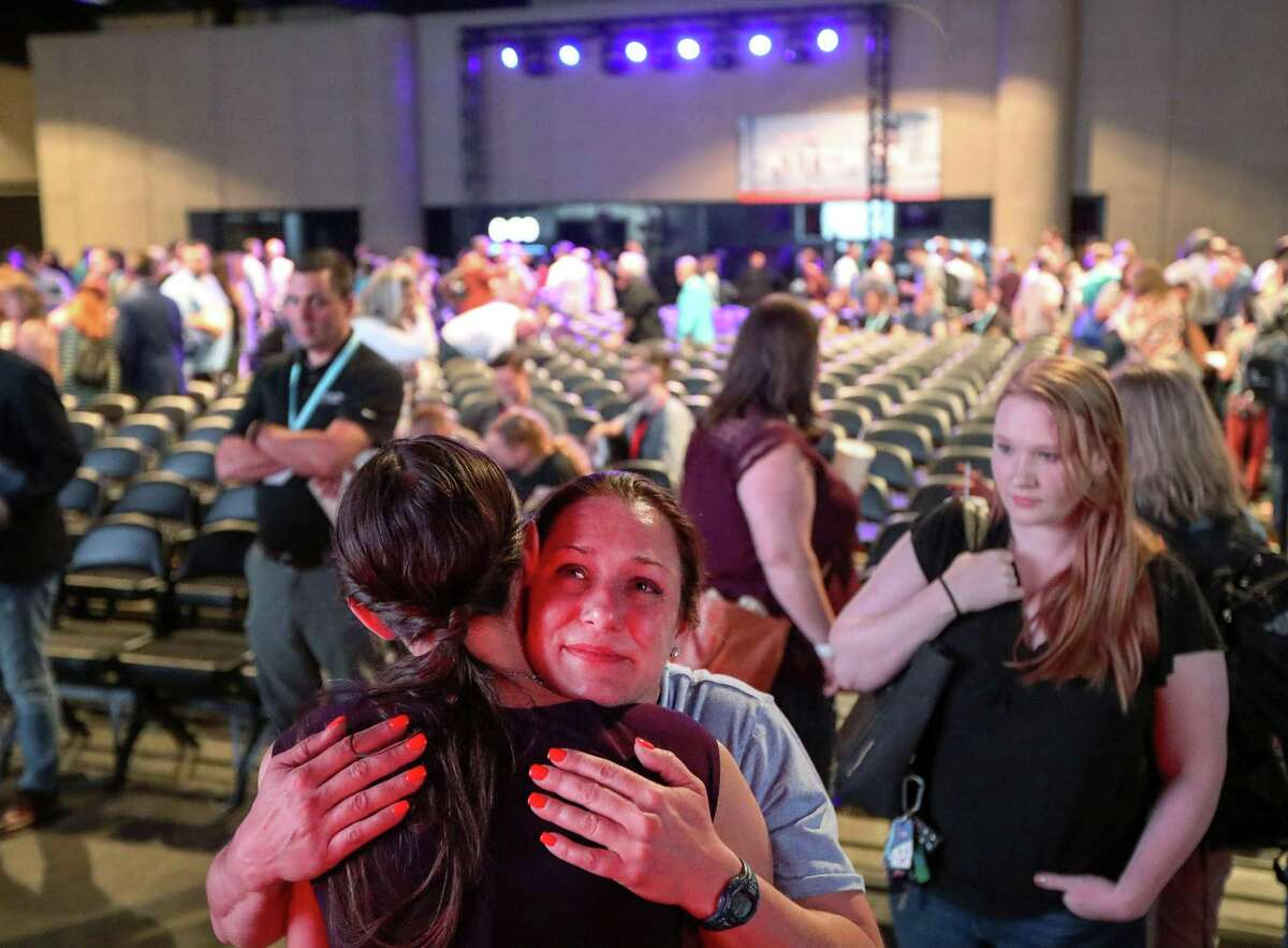Jules Woodson hugs Rachael Denhollander, an abuse survivor, after a panel discussion about sexual abuse and Southern Baptist churches, on the eve of the SBC's annual meeting on Monday, June 10, 2019, in Birmingham.