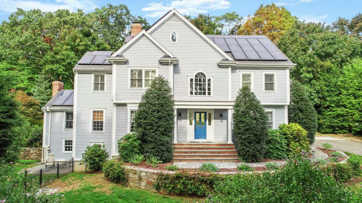 The gray colonial house at 233 High Meadow Road in Southport active has solar panels.