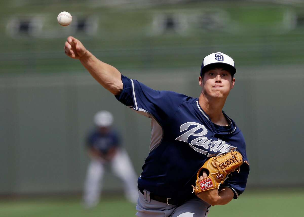 San Diego Padres' Matt Wisler throws during the second inning of a spring exhibition baseball game against the Texas Rangers Sunday, March 23, 2014, in Surprise, Ariz. Wisler was signed to a one-year contract by the San Francisco Giants.