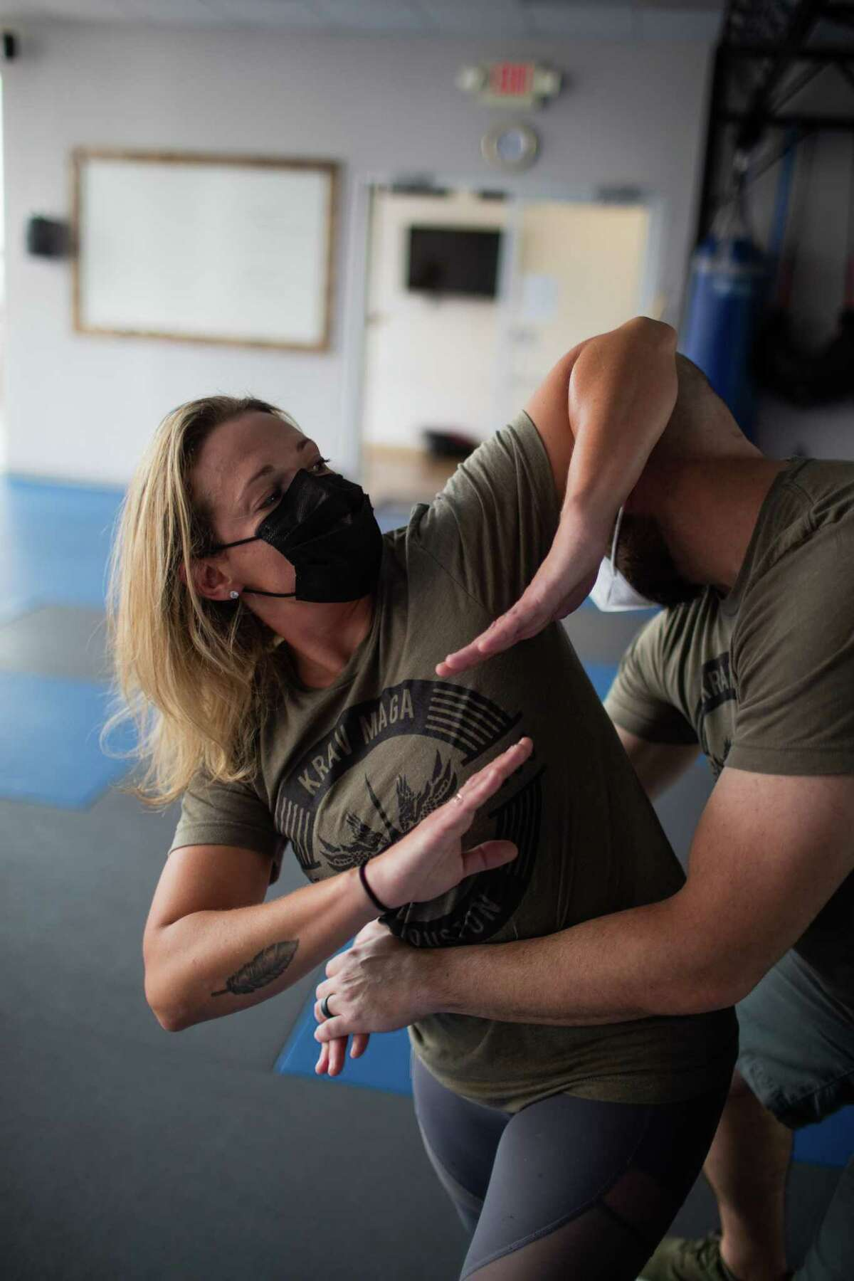 Sheryl Weinstock demonstrates self defense techniques with her instructor James Newman at Krav Maga Houston where she trains, Friday, Nov. 13, 2020, in Houston.