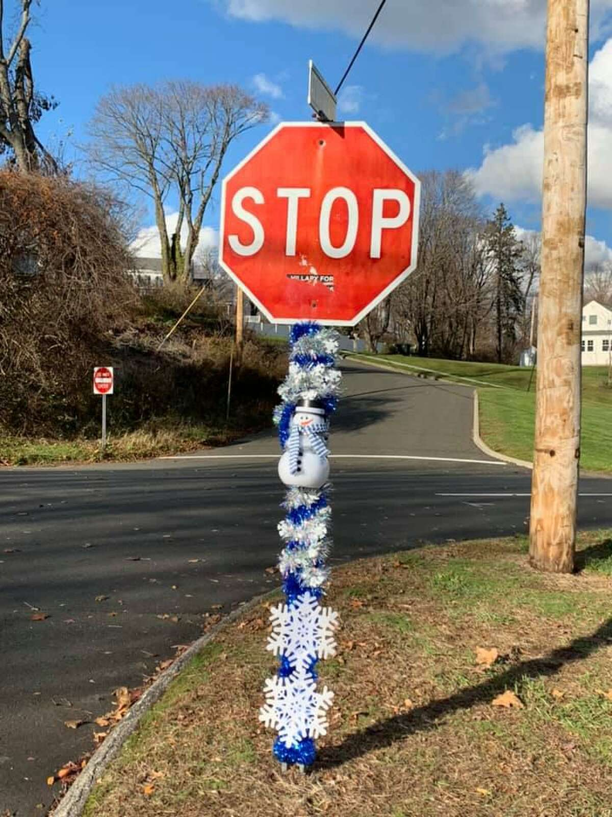 As part of an initiative called #milfordchallenge, street signs are being decorated for the holidays. Police, though, caution that the signs are city property and placing anything on them is illegal.