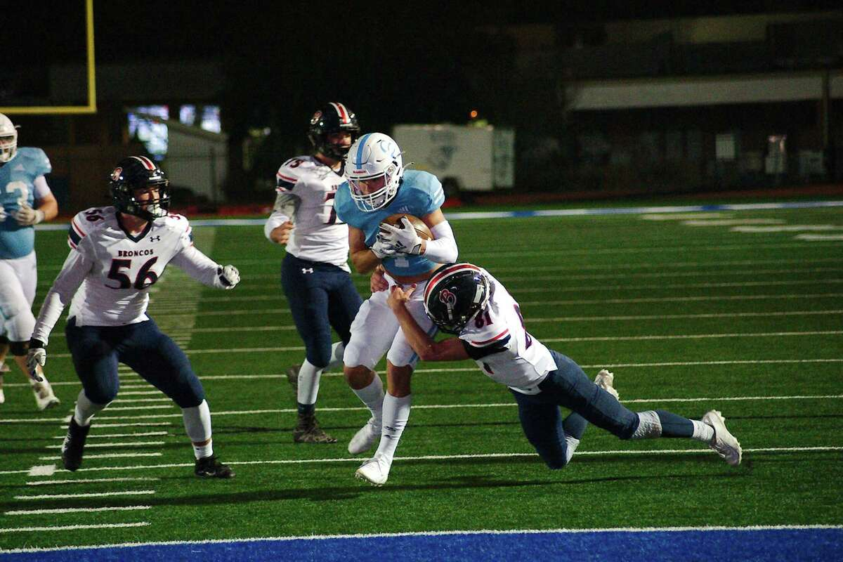 Cypress Christian's Joshua Storey (4) fights to break the tackle of Bay Area Christian's Gannon Phillips (81) Friday, Dec. 4 at Friendswood High School.