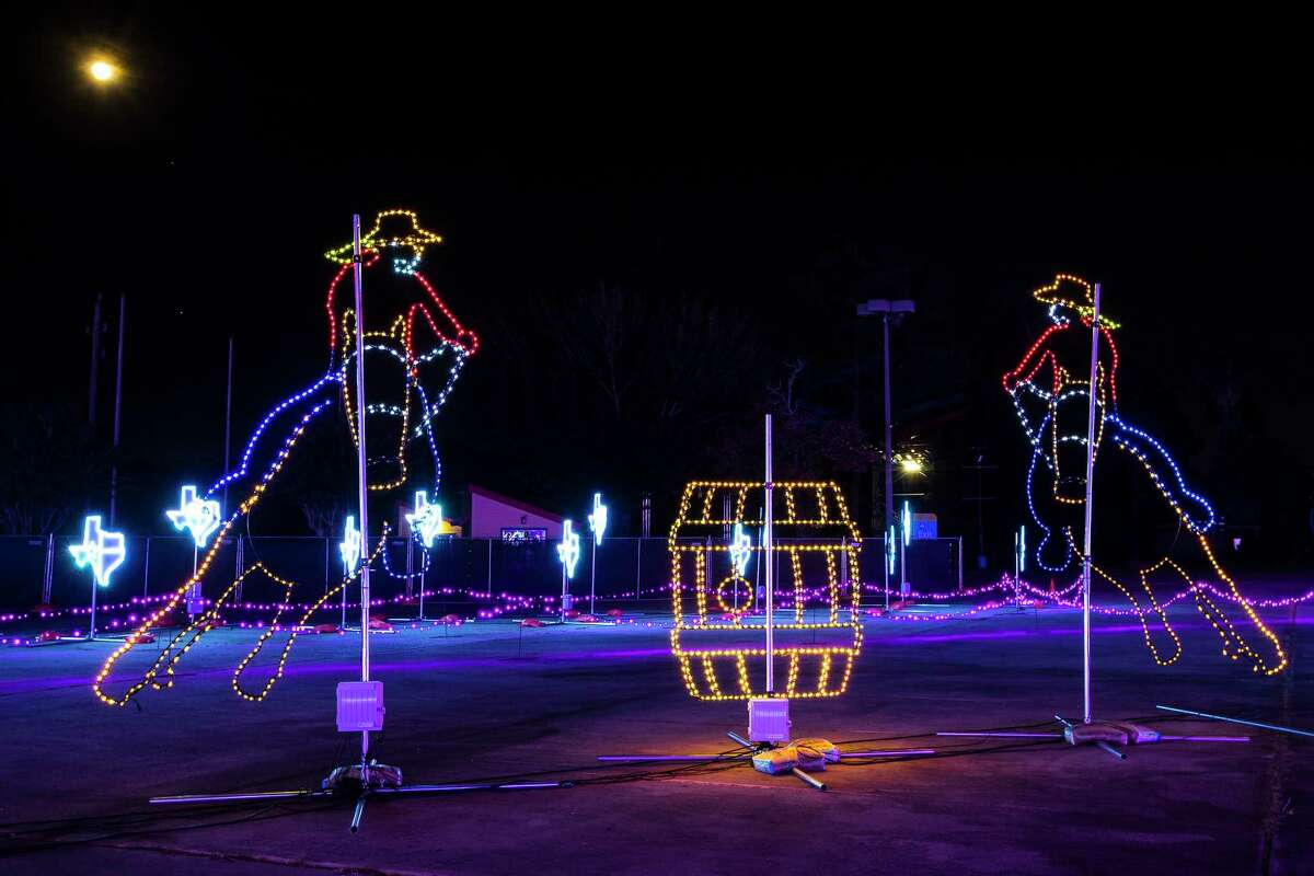 """Scenes from The Light Park, a new drive-through holiday experience are shown Monday, Nov. 2, 2020 in Spring. The attractions include a 700-foot long animated LED tunnel. All told, the park boasts more than 1 million LED lights for a one-mile show that is synched and choreographed to holiday music on a dedicated station. """"Character DJs"""" including Santa, DJ Snowflake, Pixel Penguin and Barry Bear will work candy-cane turntables, adding to the cheer. Each pass-through ride will be different."""