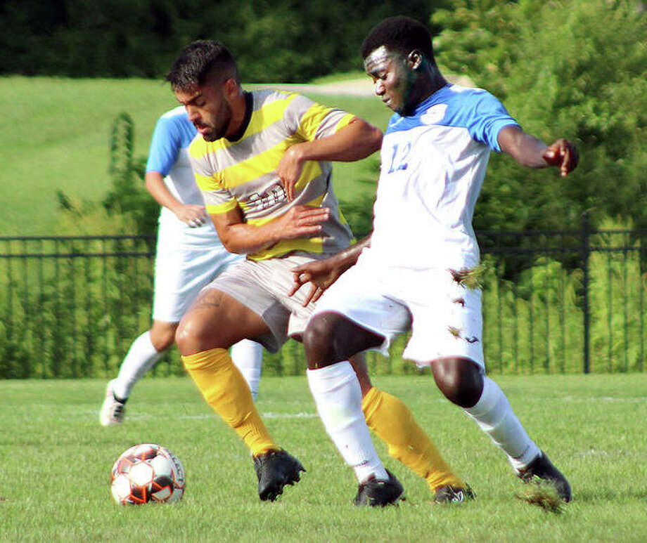 LCCC's Kofi Awuah, right, is one of nine international players who figure to play next spring when the Trailblazers and the NJCAA play the rescheduled men's soccer season. Awuah is a sophomore from Ontario, Canada. He is down in action last season. Photo: Pete Hayes File | The Telegraph