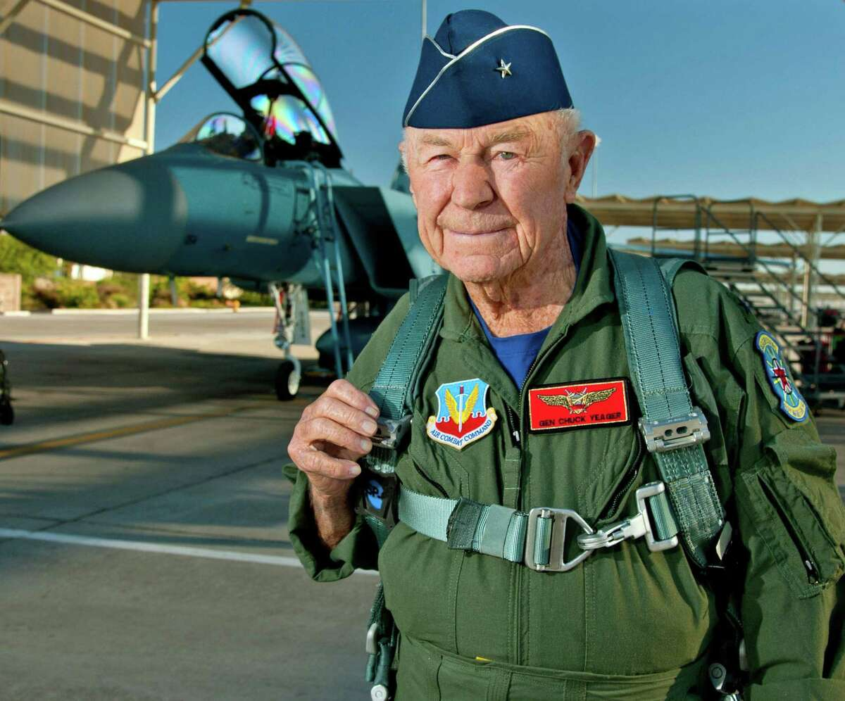 """In this file handout photo taken on October 14, 2012 Retired United States Air Force Brig. Gen. Charles E. """"Chuck"""" Yeager prepares to board an F-15D Eagle from the 65th Aggressor Squadron at Nellis Air Force Base, Nevada. Yeager died on Monday in Los Angeles at the age of 97."""