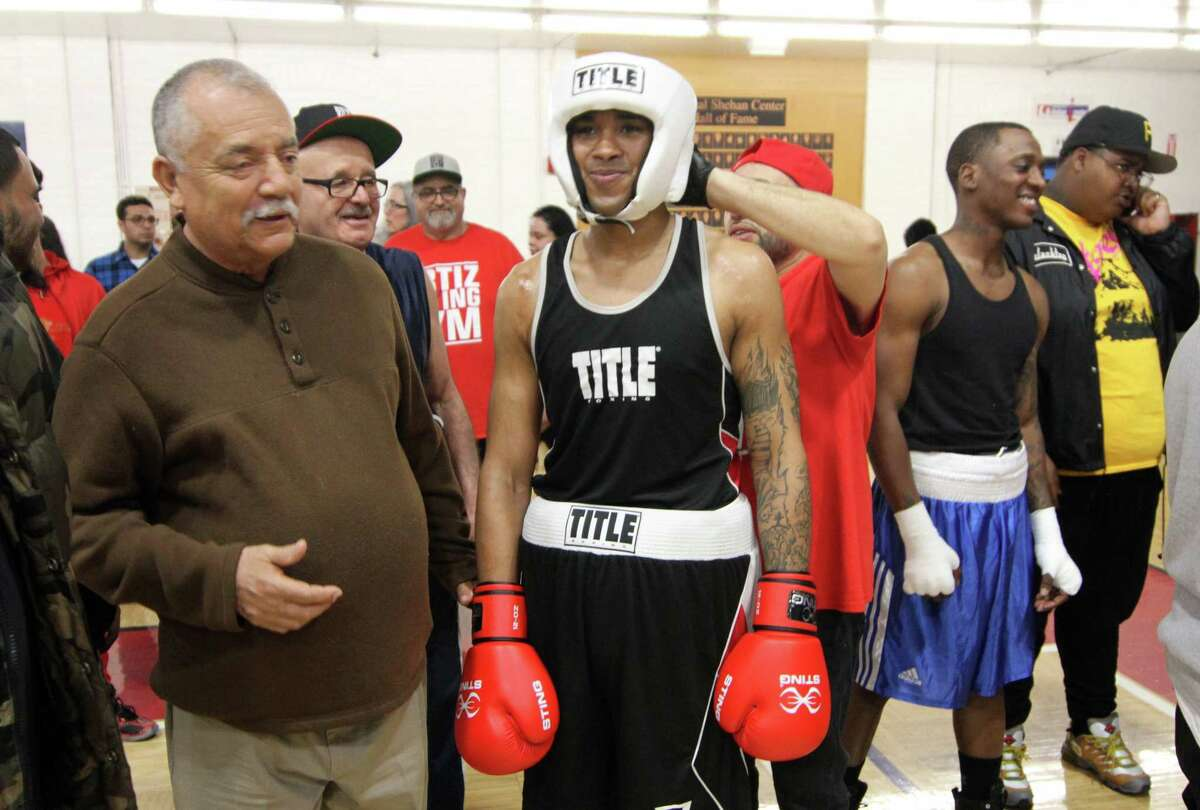 Amateur boxer Raymond Sierra gets ready to fight at the Park City Amateur Fight Night 15 at the Cardinal Shehan Center in Bridgeport, Conn., on Saturday April 6, 2019.