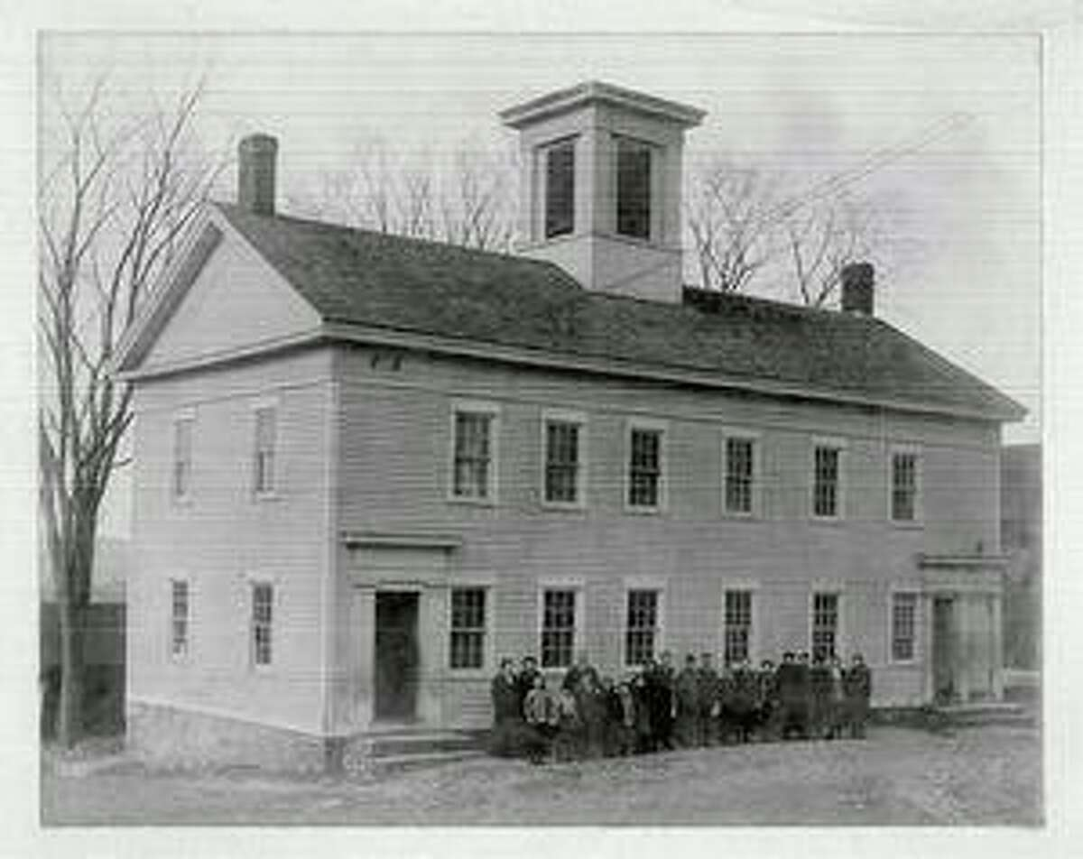 The Grange Hall, located between Main and Center streets in Bridgewater, was built in 1854 as a meetinghouse before the town was incorporated. Over the years, it was re-purposed into a meeting place, town hall, school and, eventually, grange hall. In 1901, the local grange purchased the building and established the home of Bridgewater Grange #153, which is gearing up for its 120th anniversary. Ninety-eight years later, the hall was sold to the town for $1 with the understanding that the town would maintain the building and the grange organization would always be able to call it home. In more recent years, the building has been condemned, but now a group of local residents is forming a non-profit organization in hopes of preserving and restoring the structure. Numerous grange members are shown above in this undated, black and white photo. For more information about the grange hall, see story Page S1.