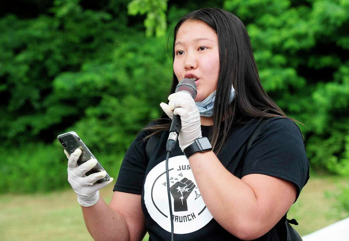 Annie Love of Stamford reads a poem at a rally for Justice for Brunch on Saturday, June 27, 2020 in Greenwich, Connecticut. A couple of hundred protesters marched from Greenwich Town Hall down Greenwich Avenue to a rally at the Island Beach Lot.