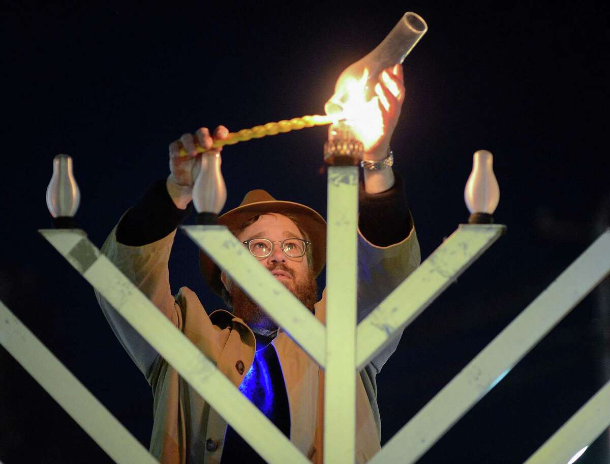 Rabbi Levi Stone of the Schneerson Center of Jewish Life lights the menorah at the Wilton town green on Dec. 22, 2019. This year the menorah will be lit Sunday, Dec. 13.