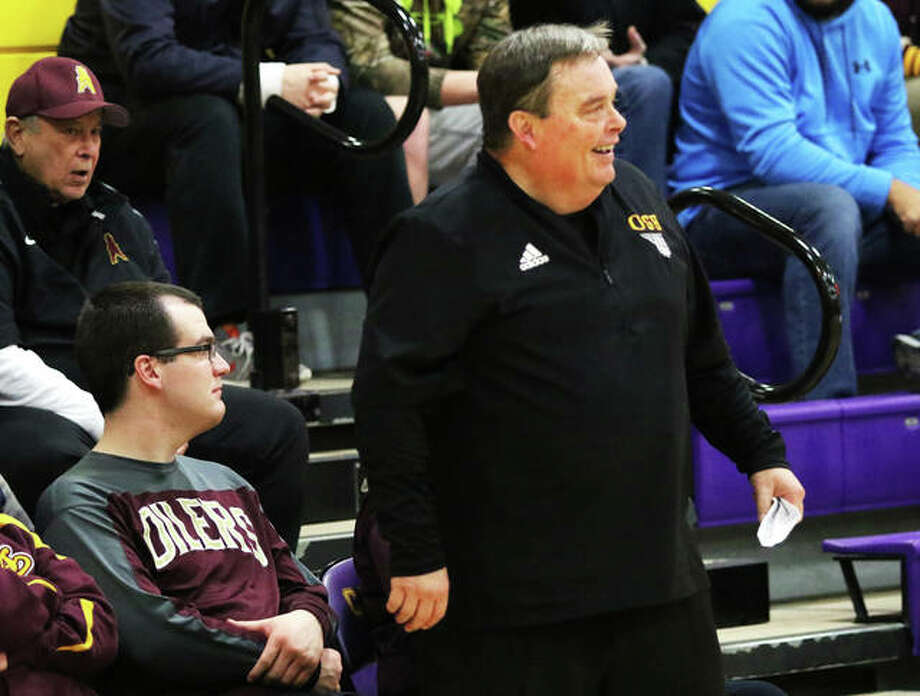 Former EA-WR basketball coach Joe Parmentier enjoys a moment of give-and-take — mostly give — with a referee during the Carlyle Class 2A Girls Regional last season. Parmentier, who is battling COVID-19, has been elected to the Illinois Basketball coaches Association Hall of Fame. He was also a longtime boys basketball, football and boys tennis coach at EA-WR. He also coached at Mount Olive and Triopia.