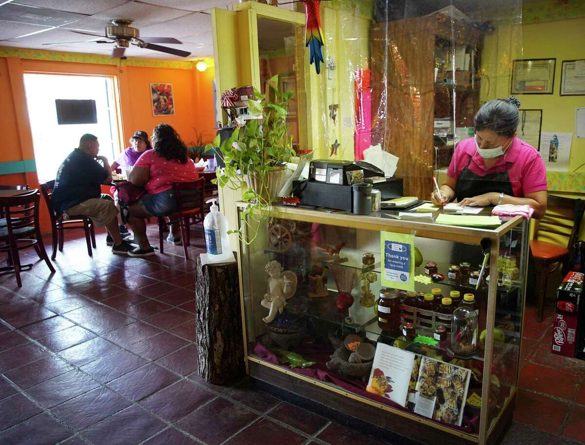 Carmen Overbay writes up an at her restaurant, Carmelita's in downtown Conroe, Texas on Tuesday, Sept. 15, 2020. Overbay and her husband, Wayne, have owned the restaurant for over two decades.