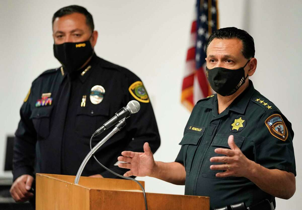 Houston Police Chief Art Acevedo, left, and Harris County Sheriff Ed Gonzalez, right, are shown at a media conference about violent road rage incidents held at HPD, 1200 Travis St., Tuesday, Dec. 8, 2020 in Houston.