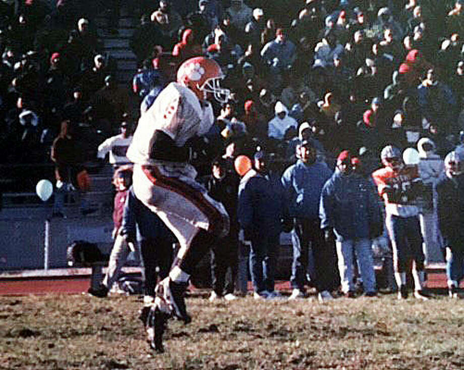 Edwardsville defensive back Ryan Jumper makes a kickoff return during a Class 5A quarterfinal playoff game against East St. Louis in 1995. Photo: For The Intelligencer