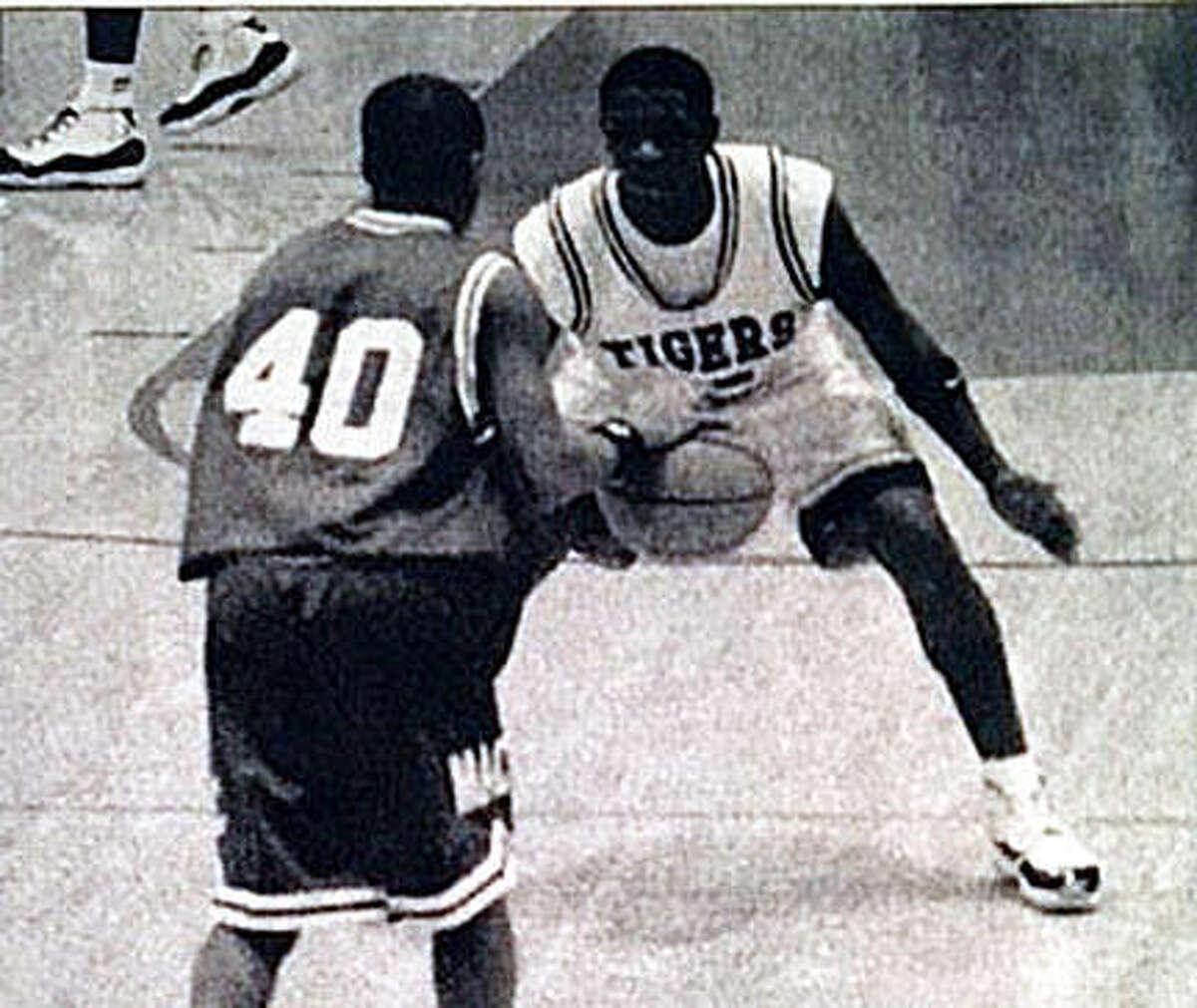 Edwardsville's Ryan Jumper, right, plays defense during his junior season at EHS in 1994-95.