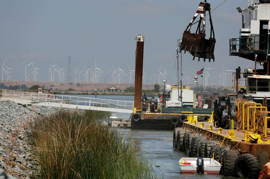 Construction crews build an emergency barrier in the West False River near Franks Tract to deter salty bay water from entering the central delta in May of 2015. The barrier was removed that November. Photo: Leah Millis/The Chronicle 2015