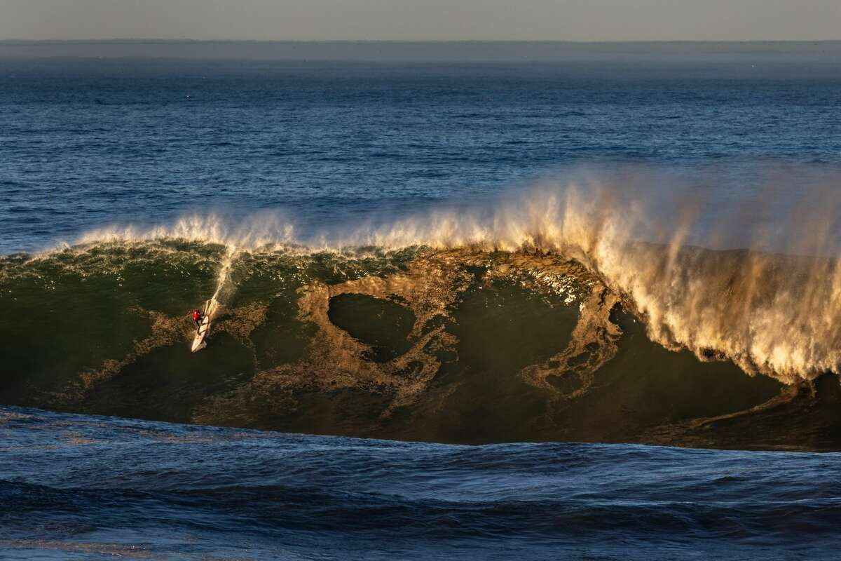 Surfers took to waves with faces ranging from 35 to 50 feet at big-wave surf spot Mavericks off the coast from Half Moon Bay, Calif., on Dec. 8, 2020.