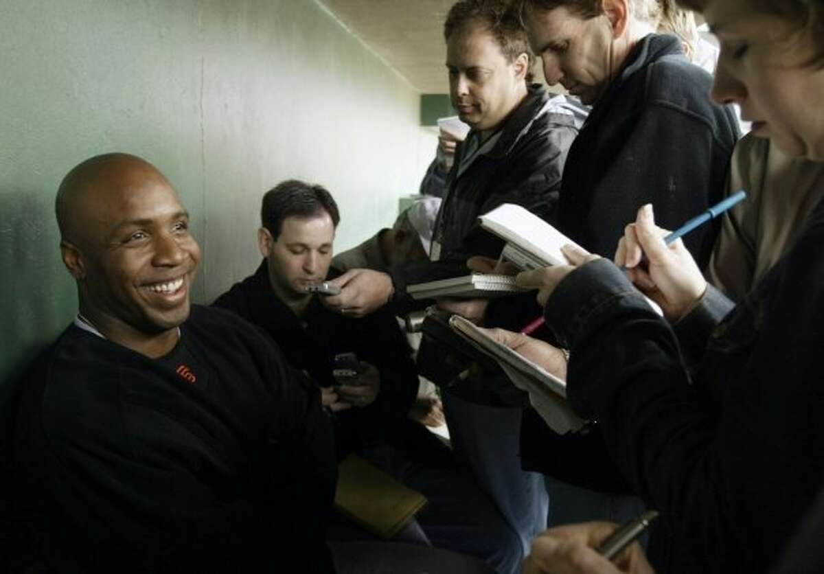 Henry Schulman, center, during a group interview with Barry Bonds in 2008
