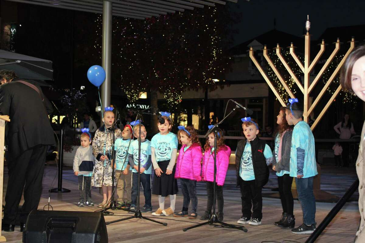 """In 2019, hundreds of people were on hand for live music, arts and crafts making, snacks and the solemn words of Rabbi Mendel Blecher, who spoke about the meaning and importance of Hanukkah. This year's Lighting of of the Menorah will be muted with no festival, no food sales and a concert from the Rogers Park Band, often called the """"Jewish Simon and Garfunkel."""""""