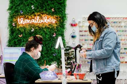 Rahey and employee Keara Ford at the Fremont office. Pamper has expanded from 15 nail painters to a network of roughly 250 freelancers across the U.S.