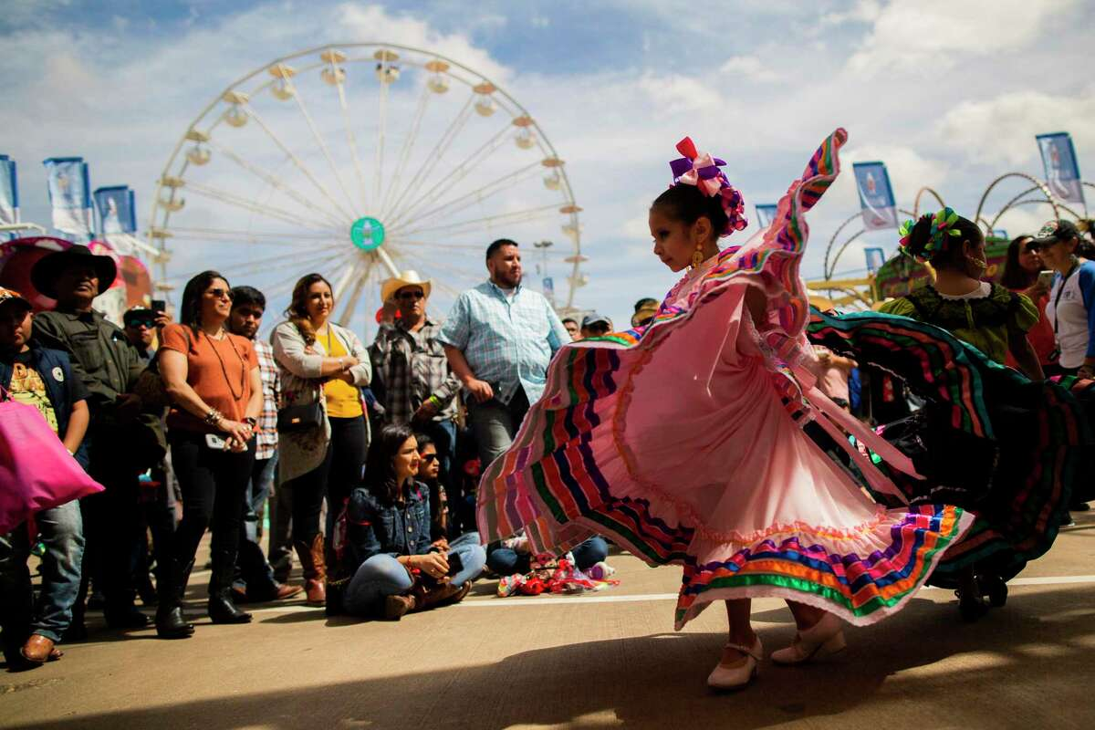 Ballet Folklorico Herencia Mexicana de Houston member Alena Mijares, 5, dances wearing a typical dress from Jalisco, Mexico during the Go Tejano Day on Sunday, March 8, 2020, in Houston.