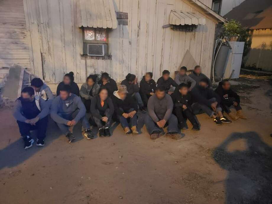 U.S. Border Patrol agents said they discovered these 17 people inside a stash house on San Francisco Avenue. All were immigrants who had crossed the border illegally. Photo: Courtesy Photo /U.S. Border Patrol