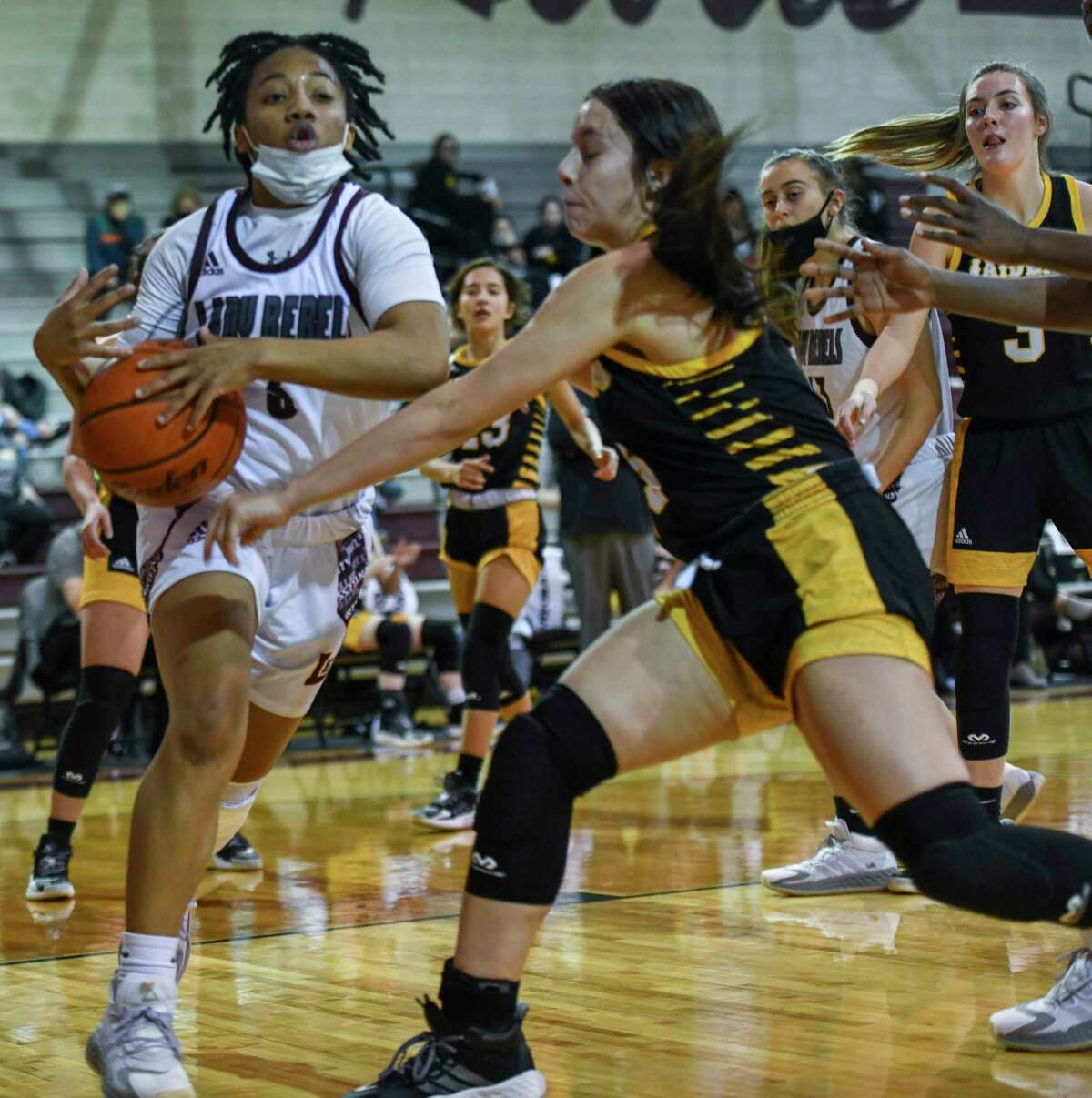 Lee's Alyssa Green has the ball knocked out of her hands by Seminole's Xoe Rosalez on Tuesday, Dec. 8, 2020 at Lee High School. Jacy Lewis/Reporter-Telegram