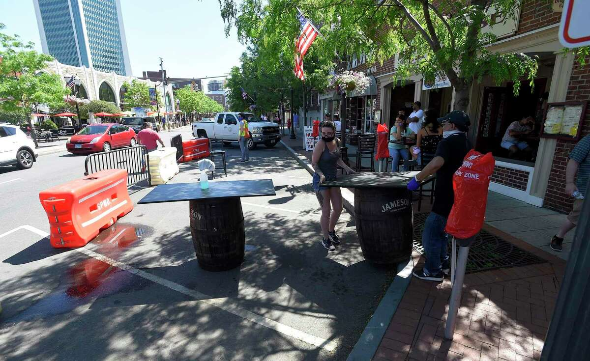 The staff of Brick House Bar and Grill set up their extended outdoor dining area on May 30, 2020 in Stamford, Connecticut. Stamford Downtown Special Services transformed a few downtown streets, like Bedford Street, into Streateries, allowing area restaurants to extend their outdoor dining into parking spaces on the street for area residents to enjoy local dining as the state begins to reopen following a two month closure in response to the COVID-19 Pandemic.