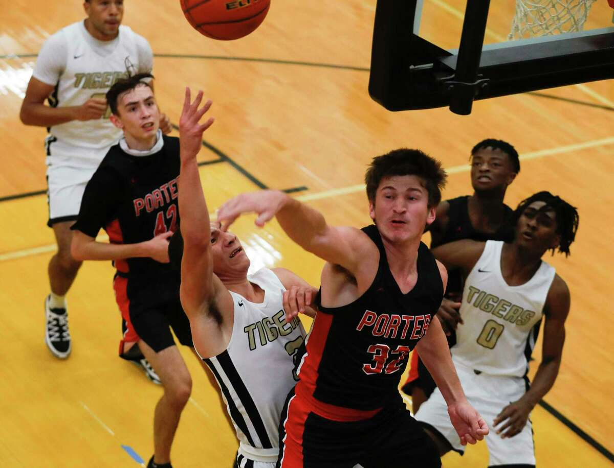 Conroe's Mikey Sneed (3) has his shot blocked by Porter's Colby Christian (32) during the first quarter of a non-district high school basketball game at Conroe High School, Tuesday, Dec. 8, 2020, in Conroe.