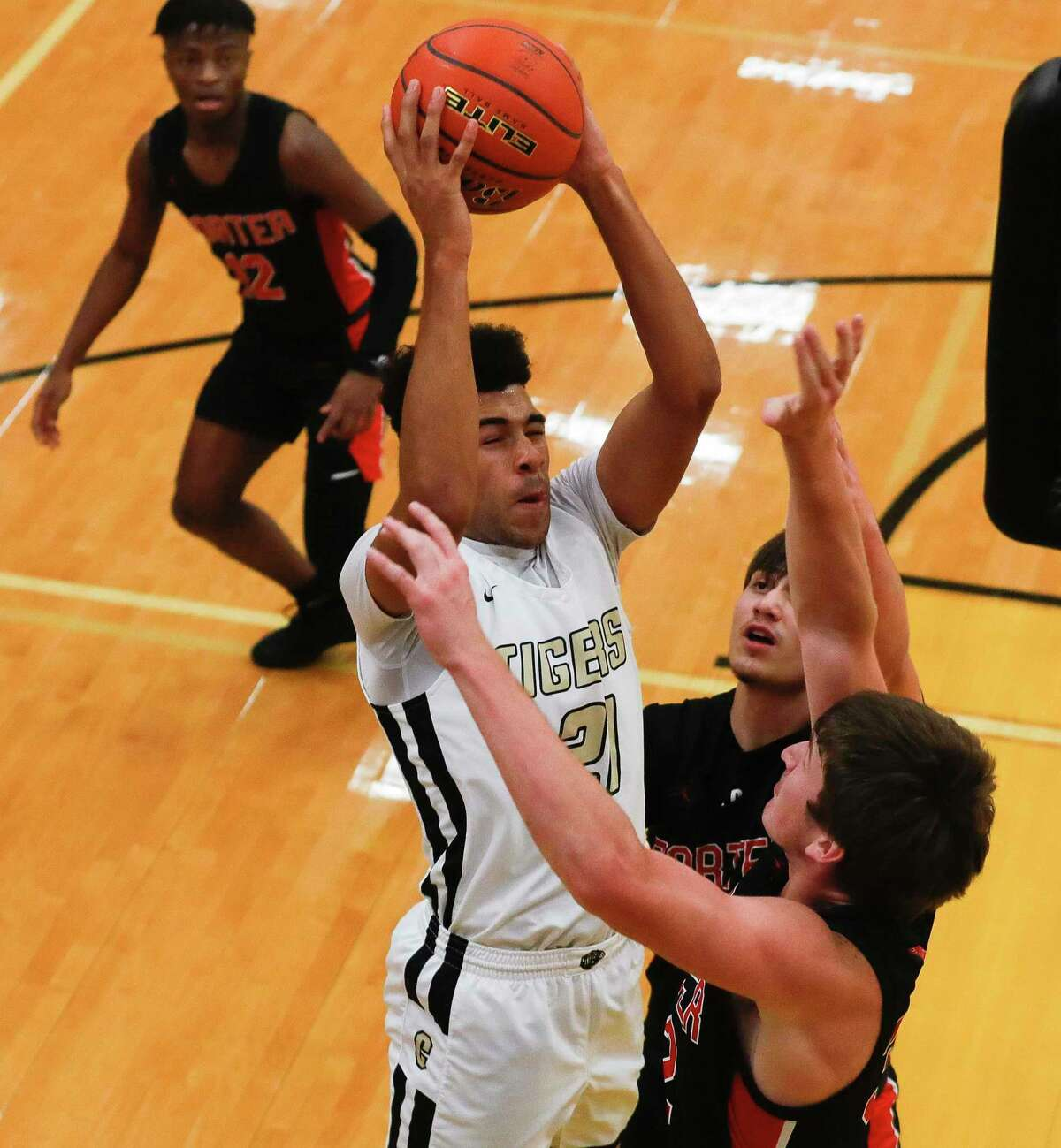Conroe's Deante Williams goes up for a shot under pressure during the first quarter of a non-district high school basketball game at Conroe High School, Tuesday, Dec. 8, 2020, in Conroe.