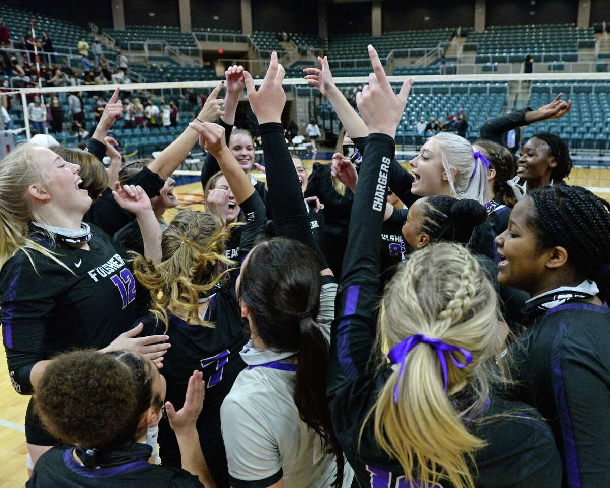 The Fulshear Chargers celebrate their 3-0 victory over the Dripping Springs Tigers in the Class 5A state semifinal volleyball match on Tuesday, December 8, 2020 at the Leonard Merrell Center in Katy.