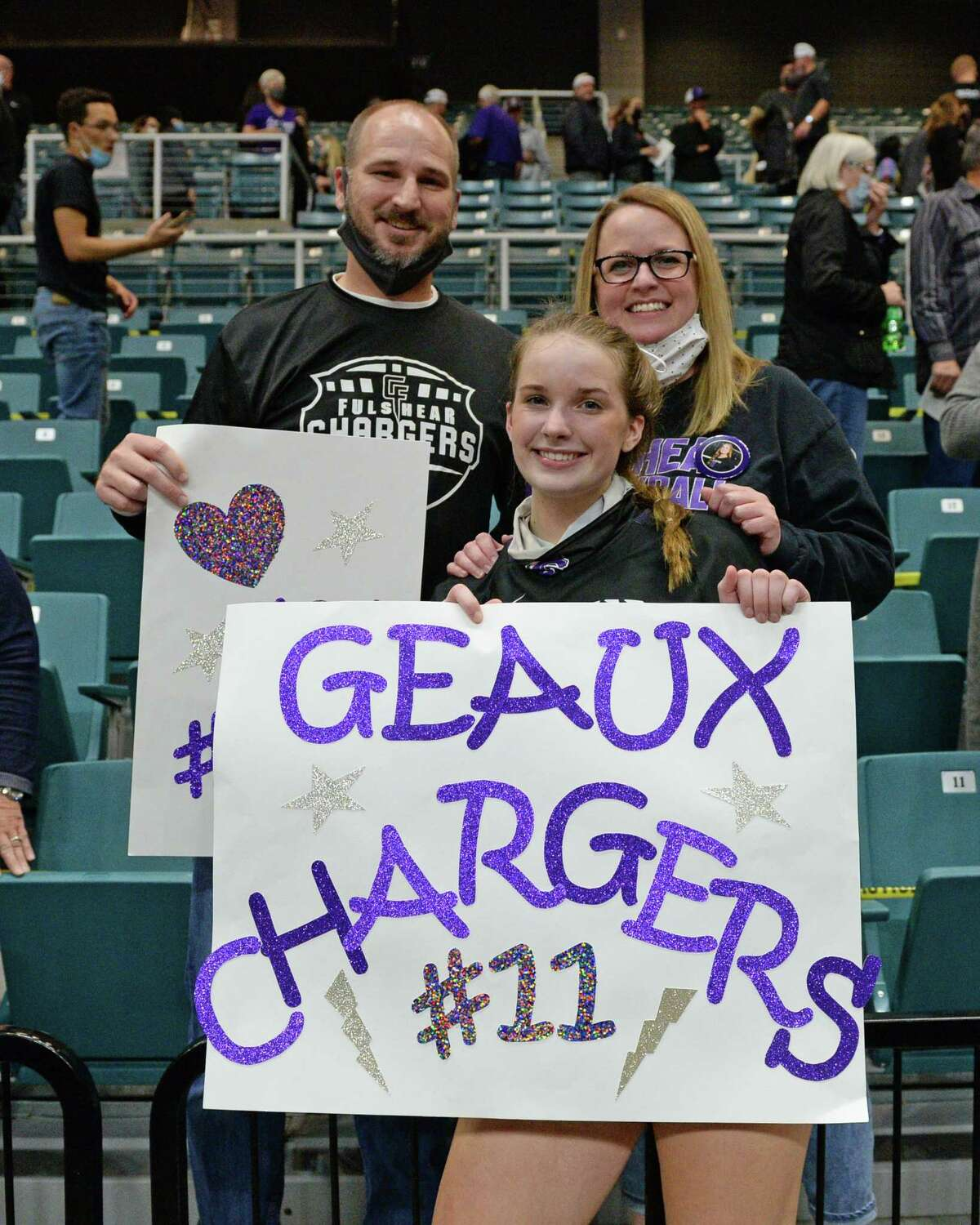 Ellie Echter (11) of Fulshear celebrates with her family after the Chargers' 3-0 victory over the Dripping Springs Tigers in the Class 5A state semifinal volleyball match on Tuesday, December 8, 2020 at the Leonard Merrell Center in Katy.