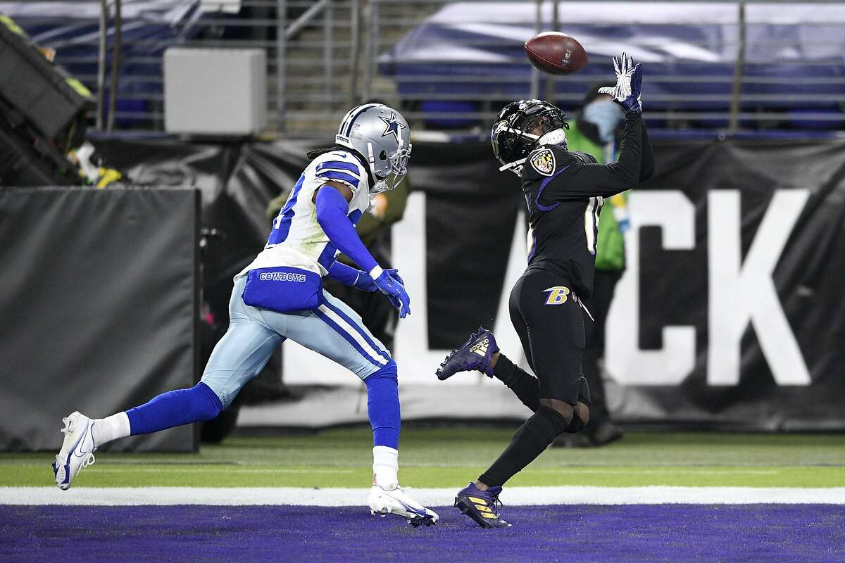 Baltimore Ravens wide receiver Marquise Brown, right, makes a touchdown catch on a pass from quarterback Lamar Jackson as Dallas Cowboys cornerback Rashad Robinson defends during the second half of an NFL football game, Tuesday, Dec. 8, 2020, in Baltimore. (AP Photo/Nick Wass)