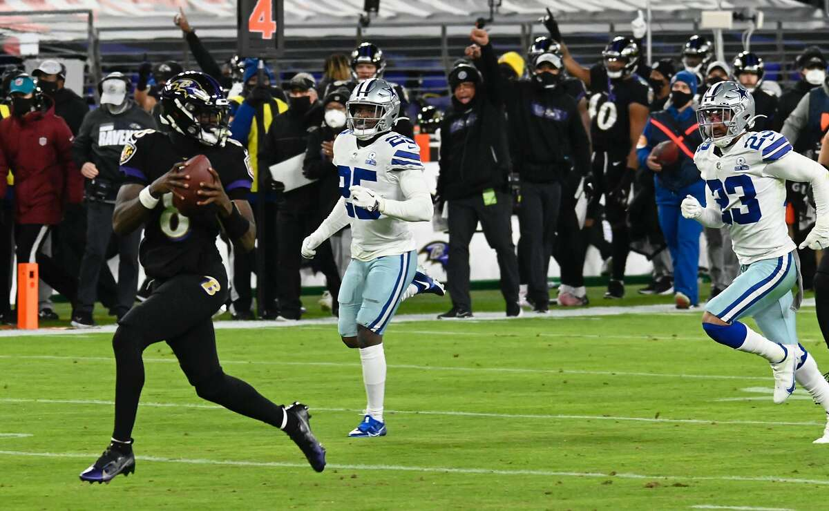 Baltimore Ravens' Lamar Jackson runs for a touchdown in the first quarter against the Dallas Cowboys on Tuesday, Dec. 8, 2020 at M&T Bank Stadium in Baltimore, Maryland. (Kenneth K. Lam/Baltimore Sun/TNS)