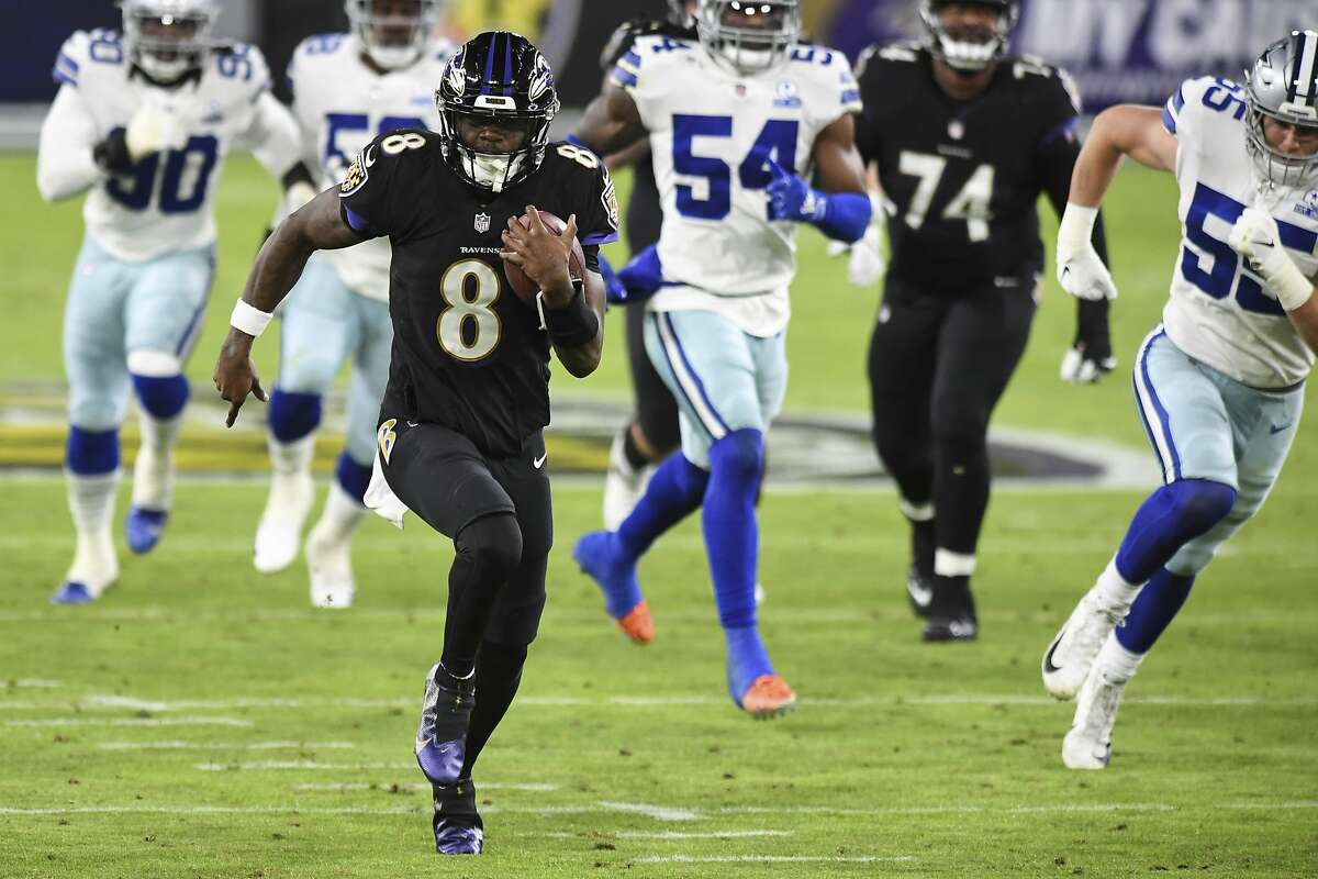 Baltimore QB Lamar Jackson beats the Cowboys' defense down the field to score on a 37-yard run in the first quarter.