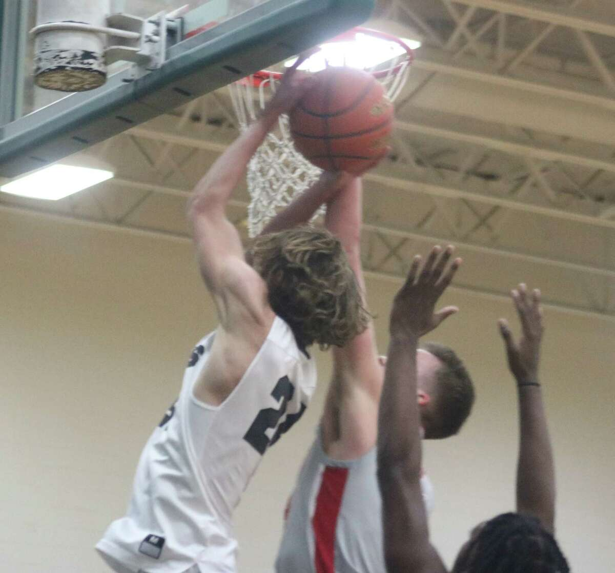 This Brock Fosnight shot is contested by Lumberton's defense Tuesday night.