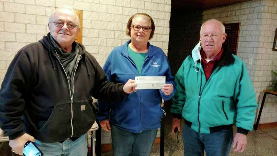 Monsignor Victor Gallagher Council #12668, St. Philip Neri Catholic Church in Reed City,recently presented a check in the amount of $684. From left is Richard Hurst, Pat Rosales, Area 5 Director, and Richard Karns, Grand Knight. (Courtesy photo)